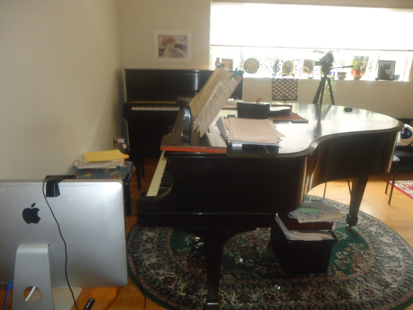 Mac back and Steinway pianos