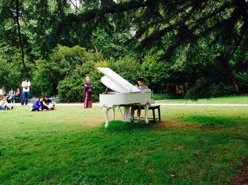 white grand piano Asian player